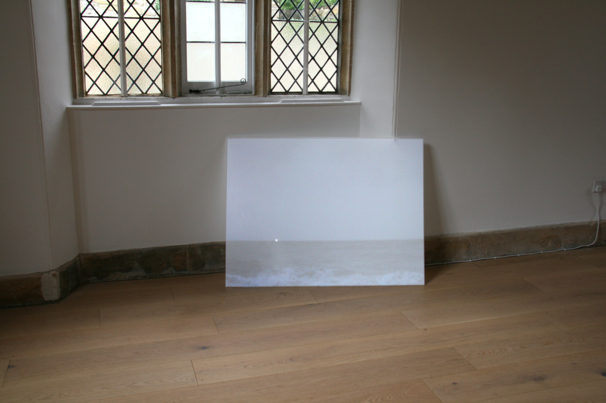 White board with a landscape projected. The landscape is the smae height as the stone skirting