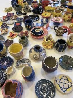 a colourful collection of handmade ceramics