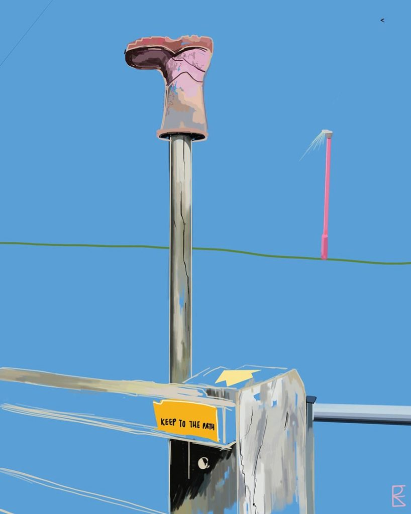 blue background with pink wellie boot updide down on a pole next to a five bar gate. in the distance is a street lamp